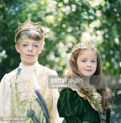 Boy and girl (8-11) wearing costumes, portrait : Stock Photo