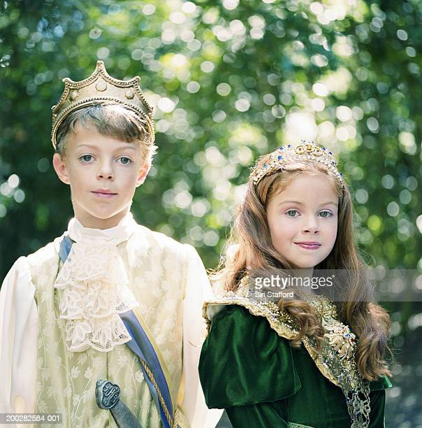 Boy and girl (8-11) wearing costumes, portrait