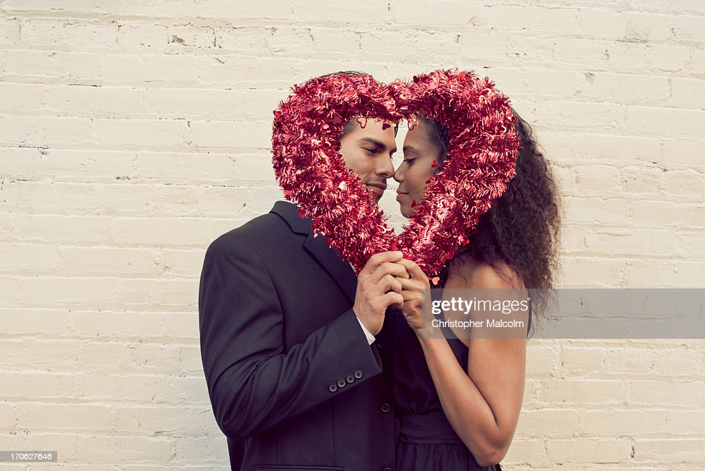 Boy and girl with a valentine heart : Stock Photo