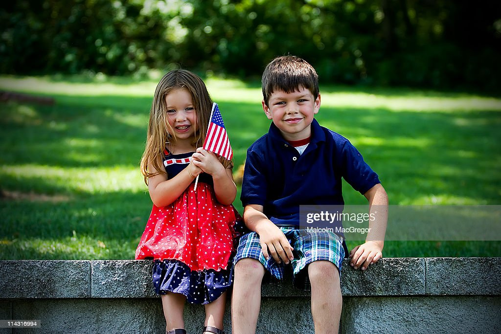 Boy and girl with American Flag : Stock Photo