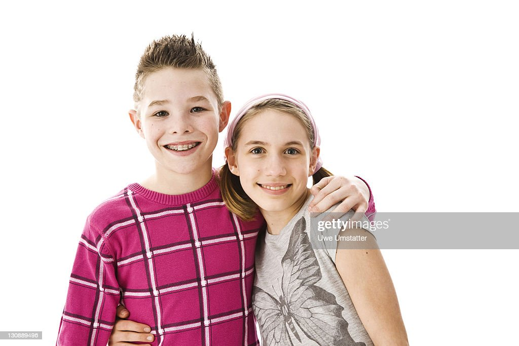 Boy and girl with their arms around each other : Stock Photo