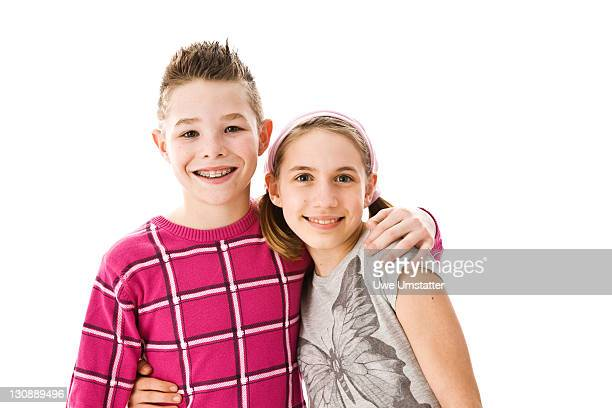 Boy and girl with their arms around each other