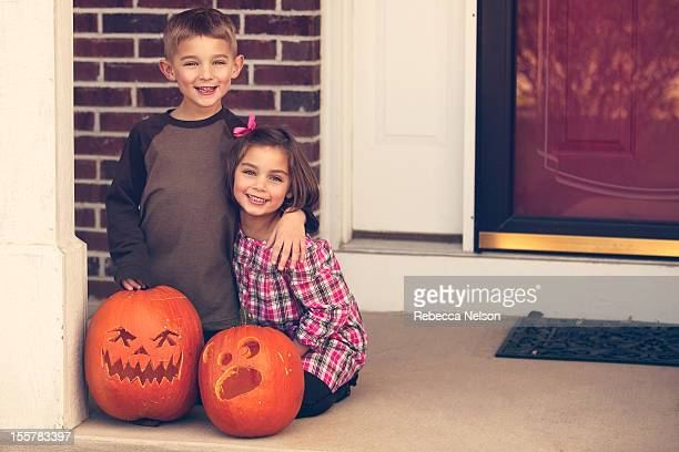 boy and girl with their jack o lanterns