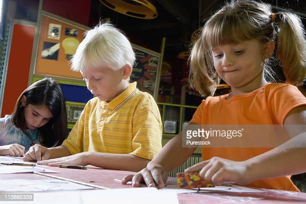 Boy and girls drawing in an art class