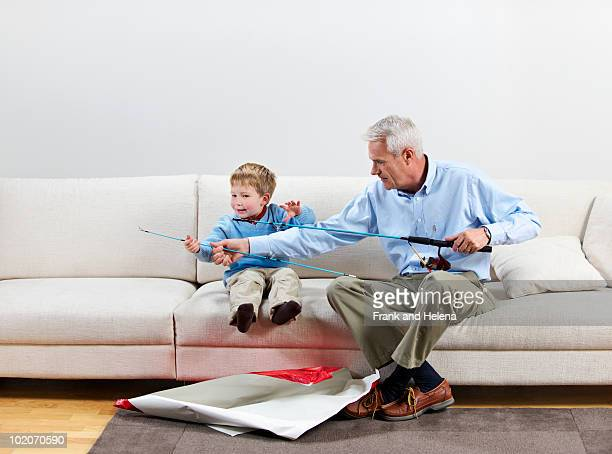 Boy and grandfather with new fishing rod