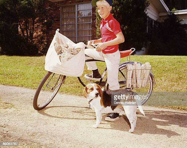 Boy and His Dog Deliver Newspapers