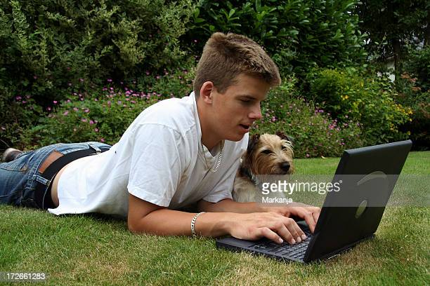 Boy and his dog working outdoors