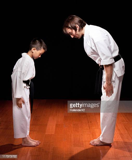 boy and Karate instructor bowing to each other