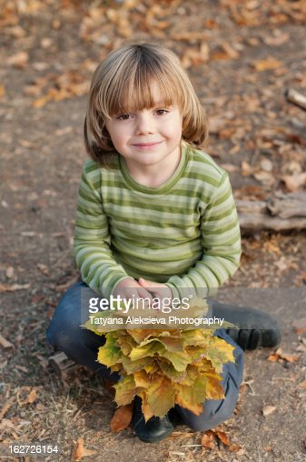 Boy and leaves