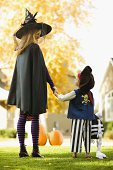 Boy and mother in Halloween costumes