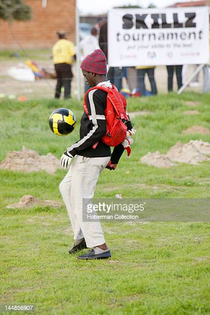 Boy and soccer ball in Township