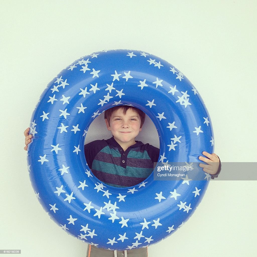 Boy and Swim Tube : Stock Photo