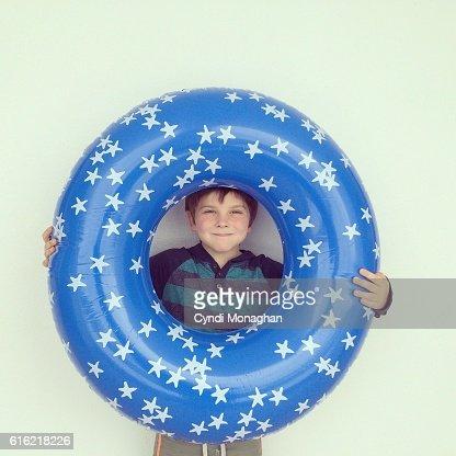 Boy and Swim Tube : Bildbanksbilder