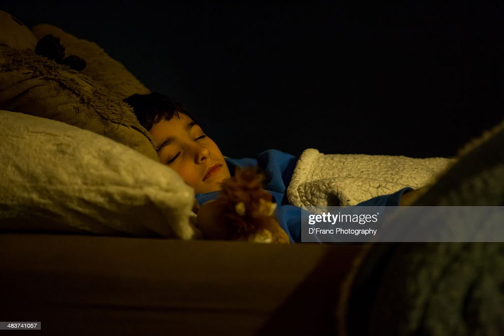 Boy and toy lion by night light