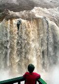 boy and waterfall