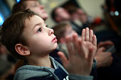 Portrait of a boy applauding in theater