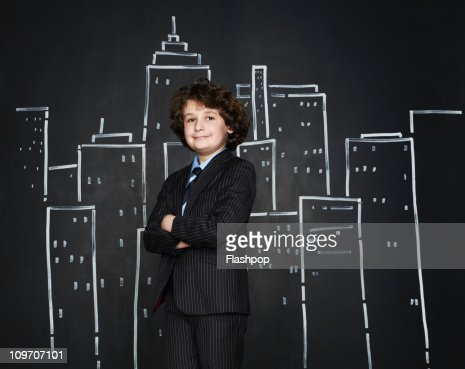 Boy as a businessman with cityscape background : Stock Photo