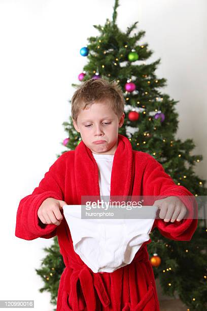boy at christmas with underwear gift