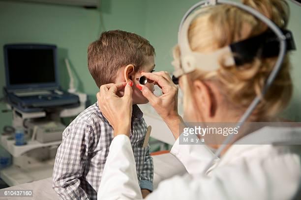 Boy at otolaryngologist's office
