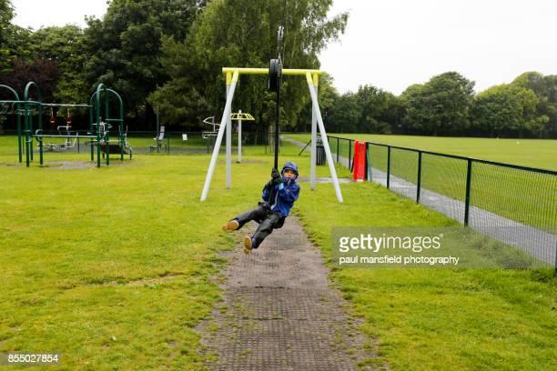 Boy at playground on a rainy day