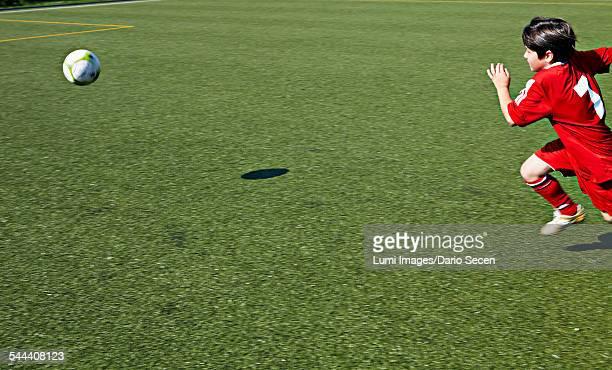 Boy at soccer training, running, Munich, Bavaria, Germany