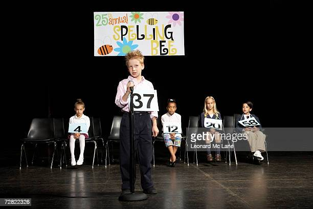 Boy (8-9) at spelling bee competition
