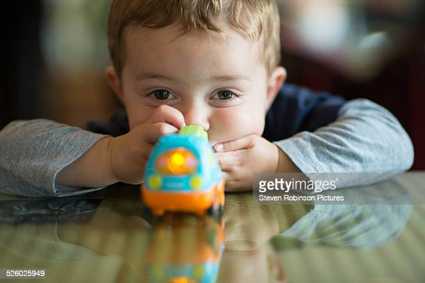 Boy at Table with Toy