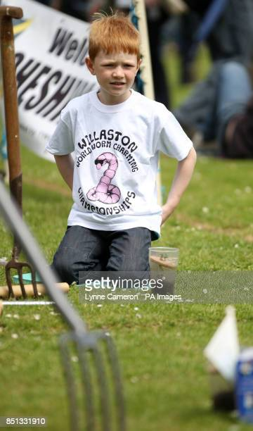 A boy at the 34th World Worm Charming Championship in Willaston Cheshire PRESS ASSOCIATION Photo Picture date Saturday June 22 2013 Photo credit...