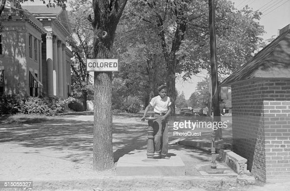 Boy at the drinking fountain on the county courthouse lawn Halifax North Carolina April 1938