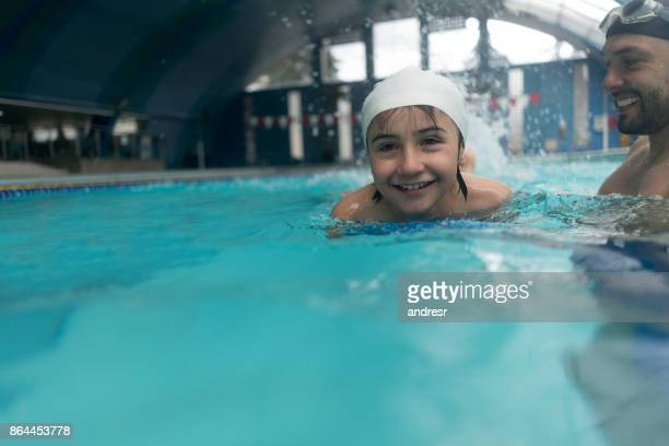 Boy at the pool in a swimming class