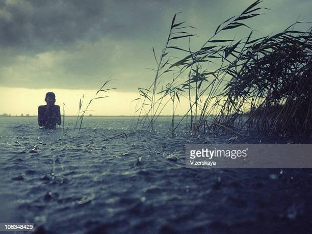 boy at water in the rain