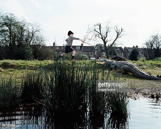 Boy attacking a crocodile