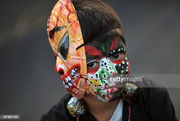 A boy attends the 'Joy for Life Carnival' in Managua on April 27 2013 AFP PHOTO/Hector RETAMAL