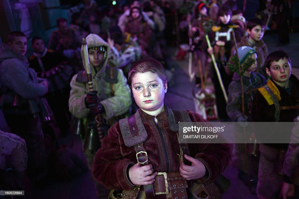 A boy attends the opening ceremony of the International Festival of the Masquerade Games in Pernik near the capital Sofia, on February 1, 2013. The three-day festival, which started on January 28, has participants sporting multi-colored masks, covered with beads, ribbons and woolen tassels whlie the main dancer, ladened with bells to drive away sickness and evil spirits, sways like a wheat spikelet heavy with grain.