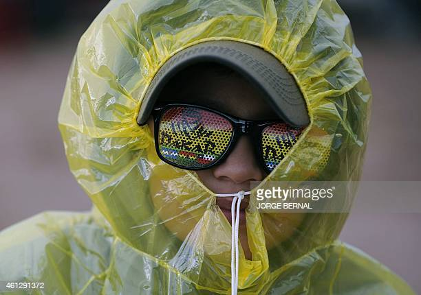 A boy attends the Stage 7 of the Dakar 2015 between Iquique in Chile and Uyuni in Bolivia on January 10 2015 AFP PHOTO/JORGE BERNAL