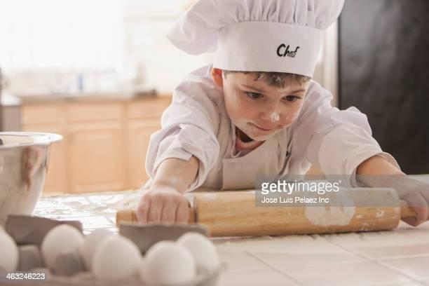 Boy baking in chef's whites