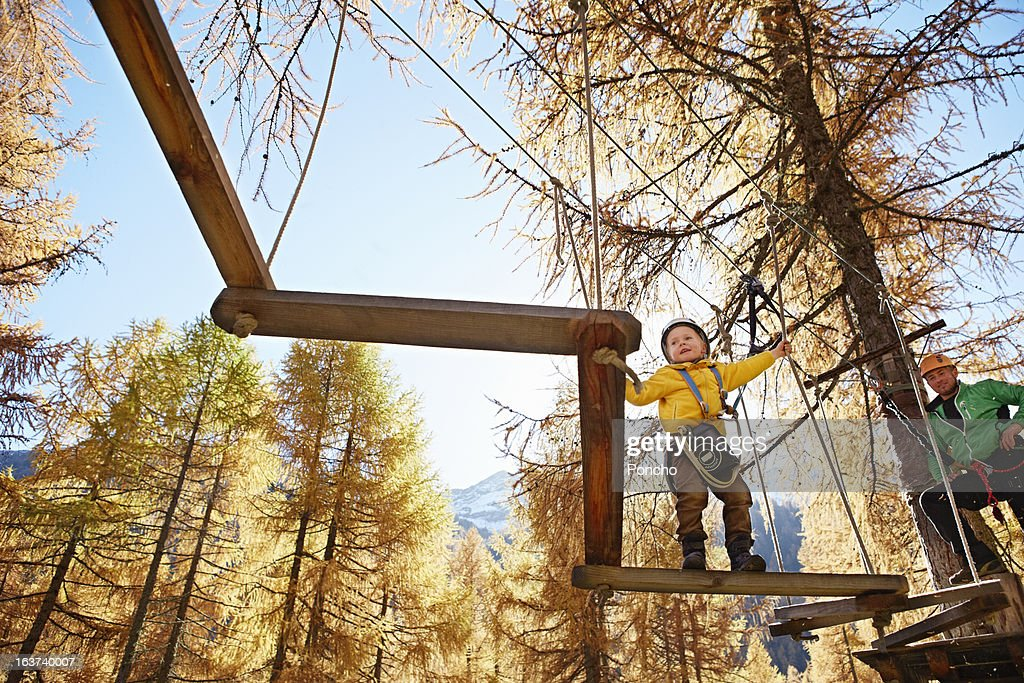 Boy balancing at a High Rope Course : Stock Photo