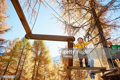 Boy balancing at a High Rope Course : Stock Photo