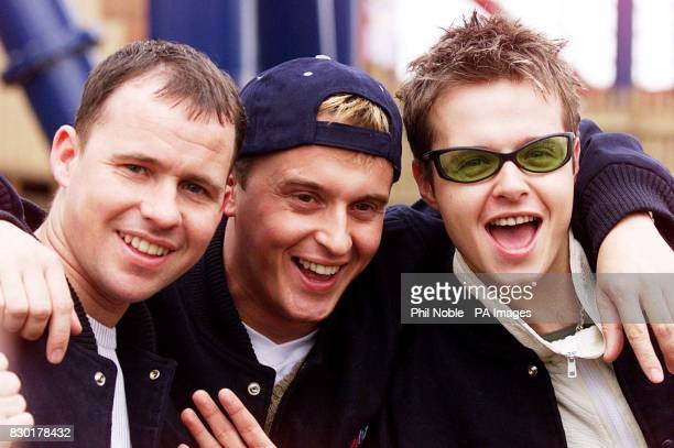 911 boy band members Simon 'Spike' Dawbarn Jimmy Constable and Lee Brenan try out the new Traumatizer ride the tallest and fastest suspended looping...