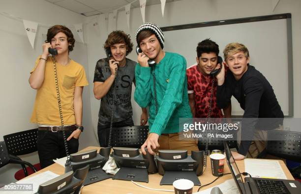 Boy band One Direction Harry Styles Liam Payne Louis Tomlinson Zayn Malik and Niall Horan during Capital FM's Help A Capital Child Appeal at Global...