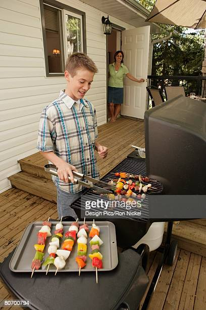 Boy barbecuing outdoors