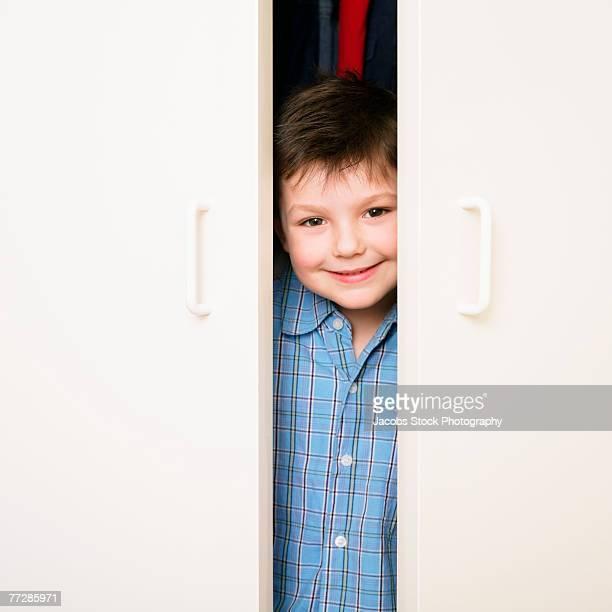Boy behind doors