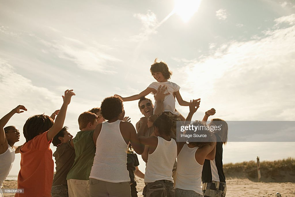 Boy being carried on shoulders : Stock Photo
