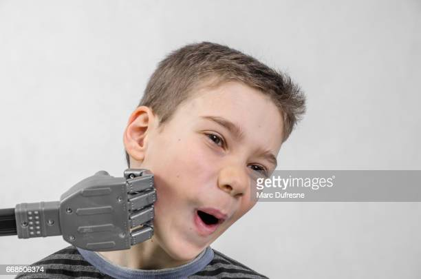 Boy being hit by a robot fist on the jaw