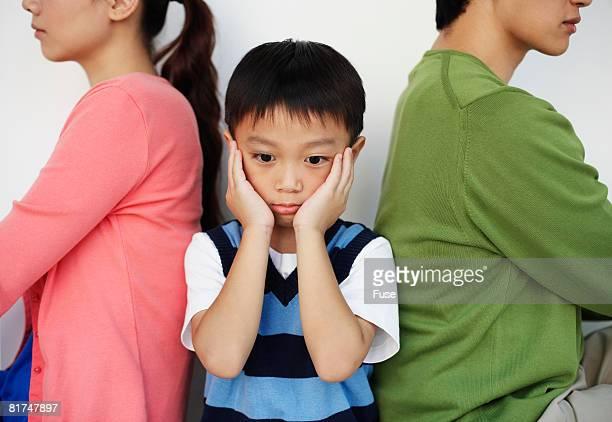 Boy Between Fighting Parents