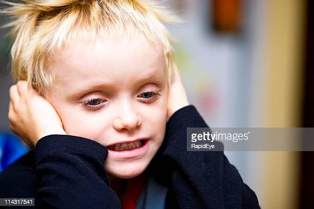 Boy blocking ears
