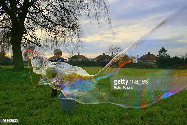 Boy blows huge bubble