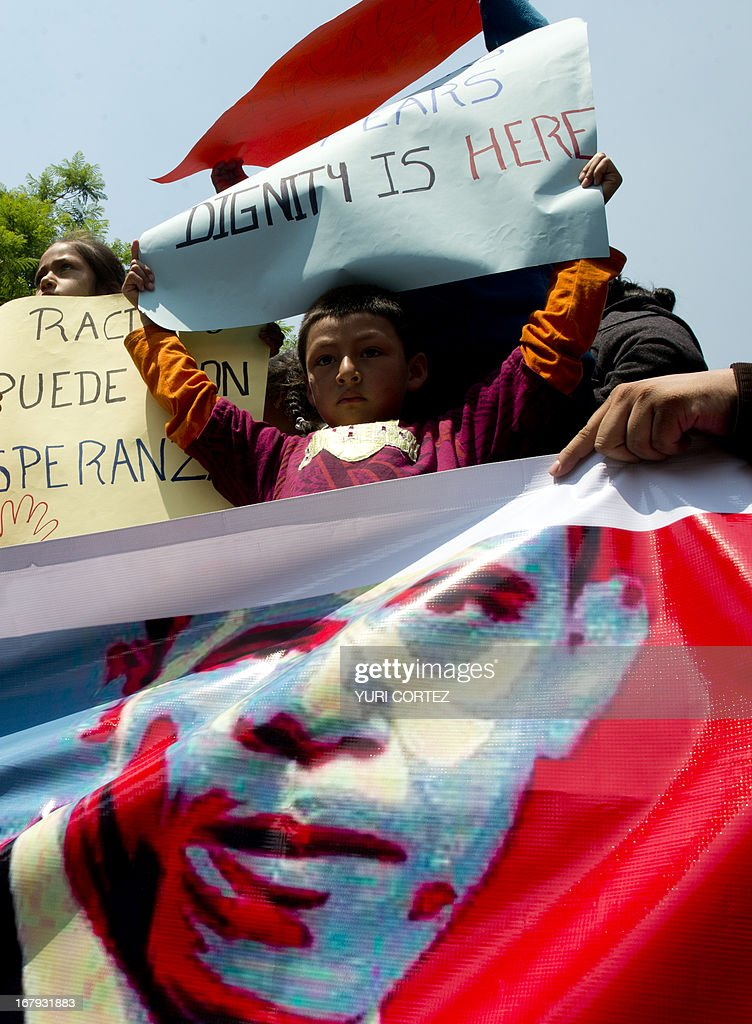 A boy born in the United States and deported to Mexico takes part in a protest organized by the Meso-American Migrant Movement to demand the deportation of Mexicans from the US to stop, on May 2, 2013 in front of the US embassy in Mexico City. Migration will be among the top issues when US President Barack Obama visits Mexico and Costa Rica this week, and many in the region hope Washington will finally act to give 11 million undocumented workers a path to citizenship. Obama headed to Mexico on Thursday to put trade back at the heart of bilateral ties, but his southern neighbour's shifting drug war tactics loom large over the visit. AFP PHOTO / Yuri CORTEZ