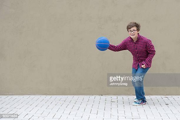 Boy bouncing basketball