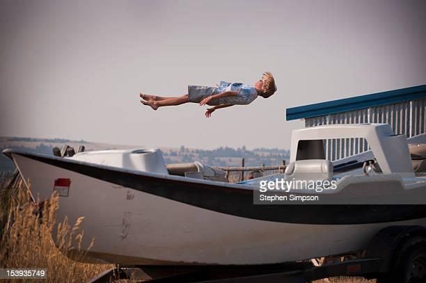 boy bouncing on an unseen trampoline